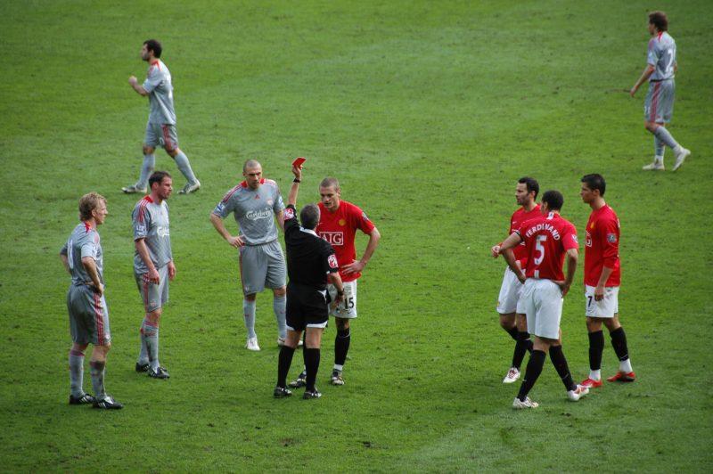 """File:2009-3-14 ManUtd vs LFC Red Card Vidic.JPG"" by Sdo216 is licensed under CC BY-SA 3.0"