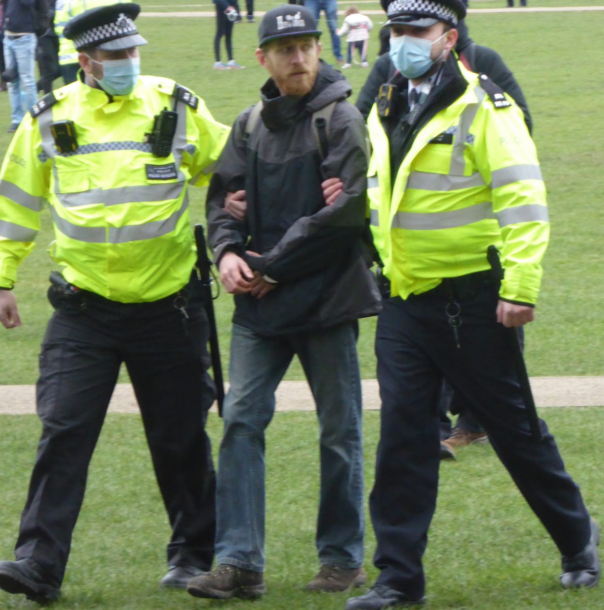 A picture of a man being led away by police at the protest in Richmond